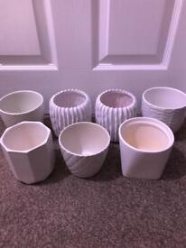 7 small white indoor plant pots