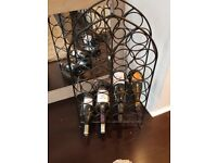 Free standing cast iron wine rack.