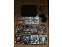 PS3 Console with 1 controller, steering wheel and 11 games, good working order