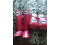 Pink leather sandee shin guards and boxing gloves