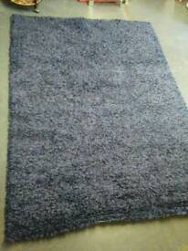 Dark blue and purple rug in great condition