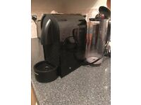 Black nearly new Nespresso coffee machine for capsules and Nespresso milk warmer