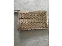 Stella & Dot Gold laser cut clutch bag