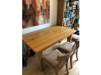 Solid Oak dining table, extendable with 2 solid oak table extensions and 6 chairs