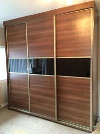 Sliding wardrobe doors made to measure from £75. Mirror, coloured glass and wood