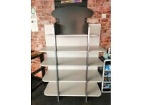 Solid open display shelving unit