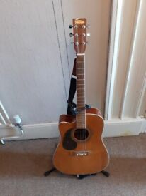 Vintage left handed electro acoustic guitar with amplifier