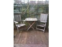2 Teak Garden tables and 6 chairs