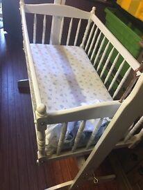 White baby rocking crib