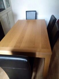 Oak dining table with 4 black leather chairs in perfect condition.