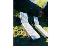 Black rattan garden furniture 2 sun loungers with cushions