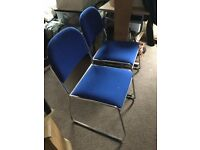 pair of stackable blue conference chairs