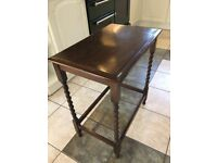 Small solid wooden table.