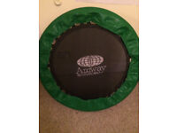 Mini exercise trampoline with training book and support bar