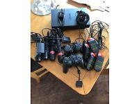 PS2 / 2 controls / singstar microphones / Buzz controls