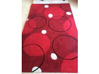 Red, black and cream rug