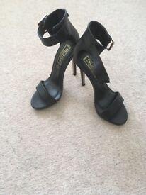 Black strappy heel sandals