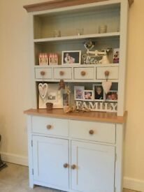 Beautiful elegant cream dresser with wood detail, it has 8 drawers and only 6 months old.