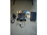 Ps2 slim with 14 games, 2x sony controllers, wires and memory card.