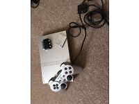 PS2 slimline silver console. 1 controller and 8MB memory card included