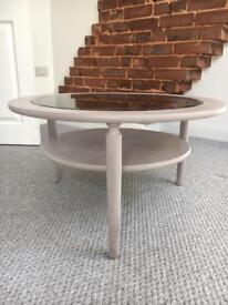 Coffee table. Round with glass centre.