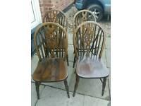 Four vintage wheelback chairs