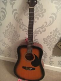 An acoustic Crafter guitar. It was brought 4years ago but hardly used