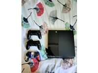 Sony Playstation 4 500GB Console, 3 controllers, charging stand and Games BUNDLE