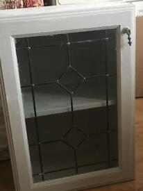 Cupboard with glass door painted in chalk paint