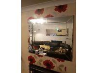 Next large bevelled mirror