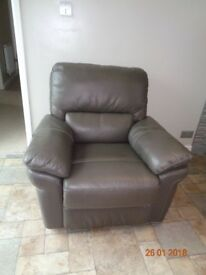 Brown Leather Reclining chair hardly used in new condition
