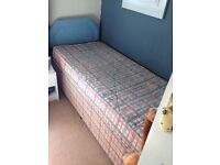 Small single divan bed with mattress. 175cm x 76cm. Few years old but good condition.