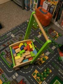 Wooden push-along cart with wooden building bricks £3.