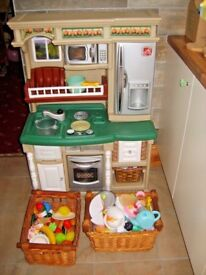 children's 'step two' toy kitchen with two baskets full of food,accessories