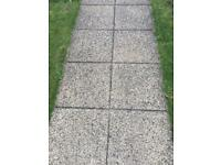 Yellow/buff square sandstone paving slabs
