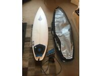 6ft6 surfboard with bag and fins