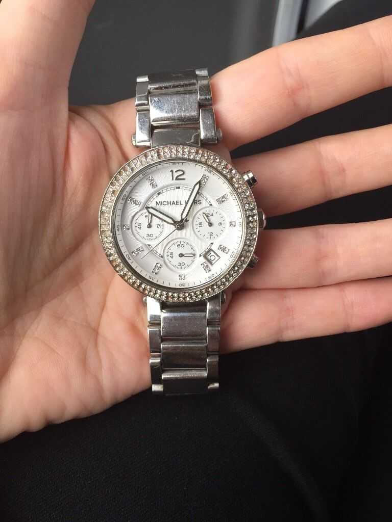 Michael Kors Watchin Trafford, ManchesterGumtree - Watch is working perfectly. Michael Kors Silver. Some stones missing on the face. Strap works well and I may have spare links depending on your size