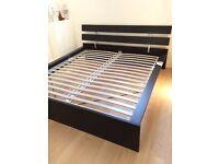 King sized Ikea Hopen bed frame in black, with memory foam mattress.