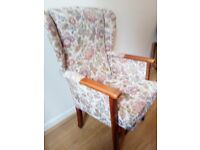 Highback Armchair with a floral pattern and with wooden legs