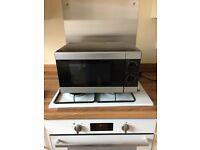 Black microwave need to sale no longer goes with the kitchen