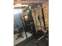 MiraFit Power Rack with Weights and Pulley System, Bench with Leg Developer, Strength Shop Barbell