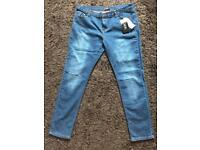 Brand New ripped Jeans Size 14/31 with Tags