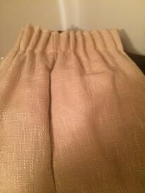 Cream full length curtains with rope tie backs