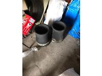 Two black chimney pots
