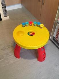 Play doh table with tools and doh