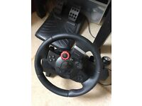 PlayStation 3 console slim with driving force steering wheel with pedals