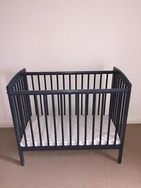 Blue compact cot