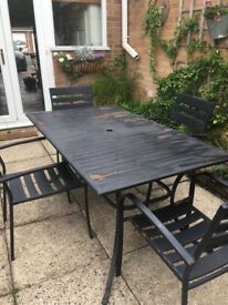 Black garden table with 4 chairs