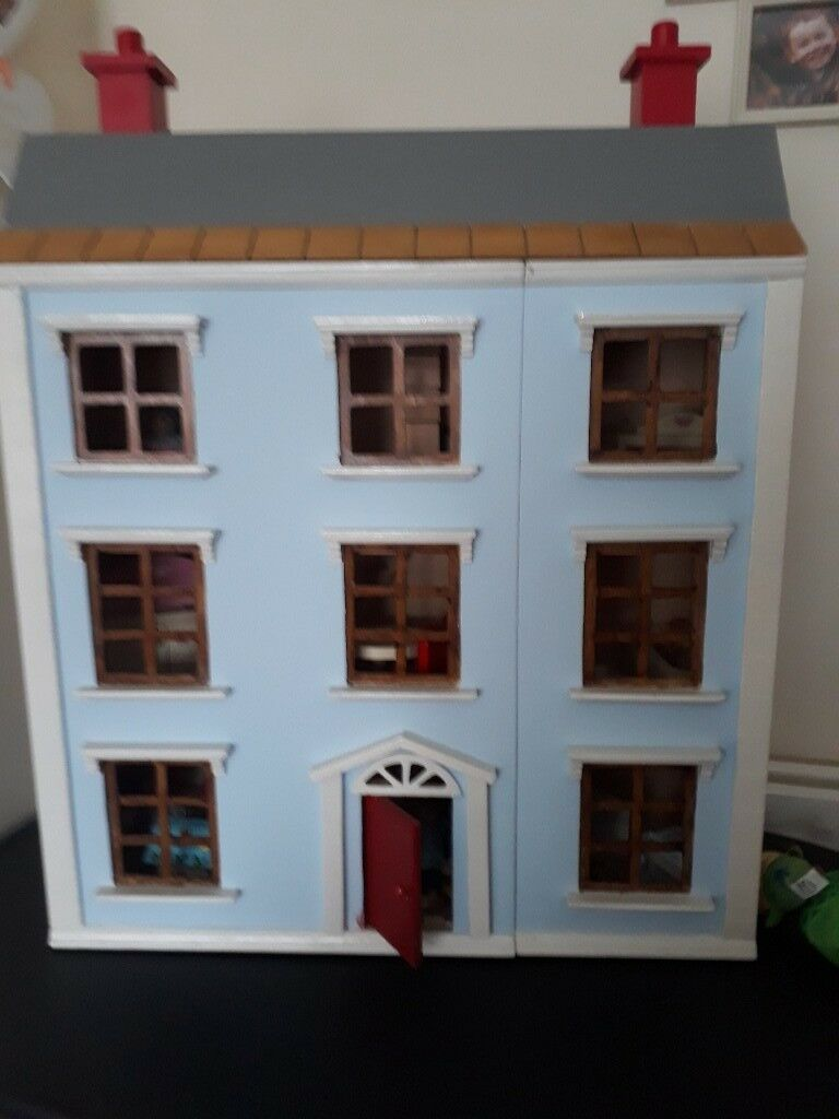 Wooden dolls house complete with furniture.