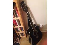 Left handed black acoustic guitar